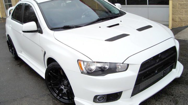 Mitsubishi Evolution X with 18 inch Forgestar F14 finished in Piano Black